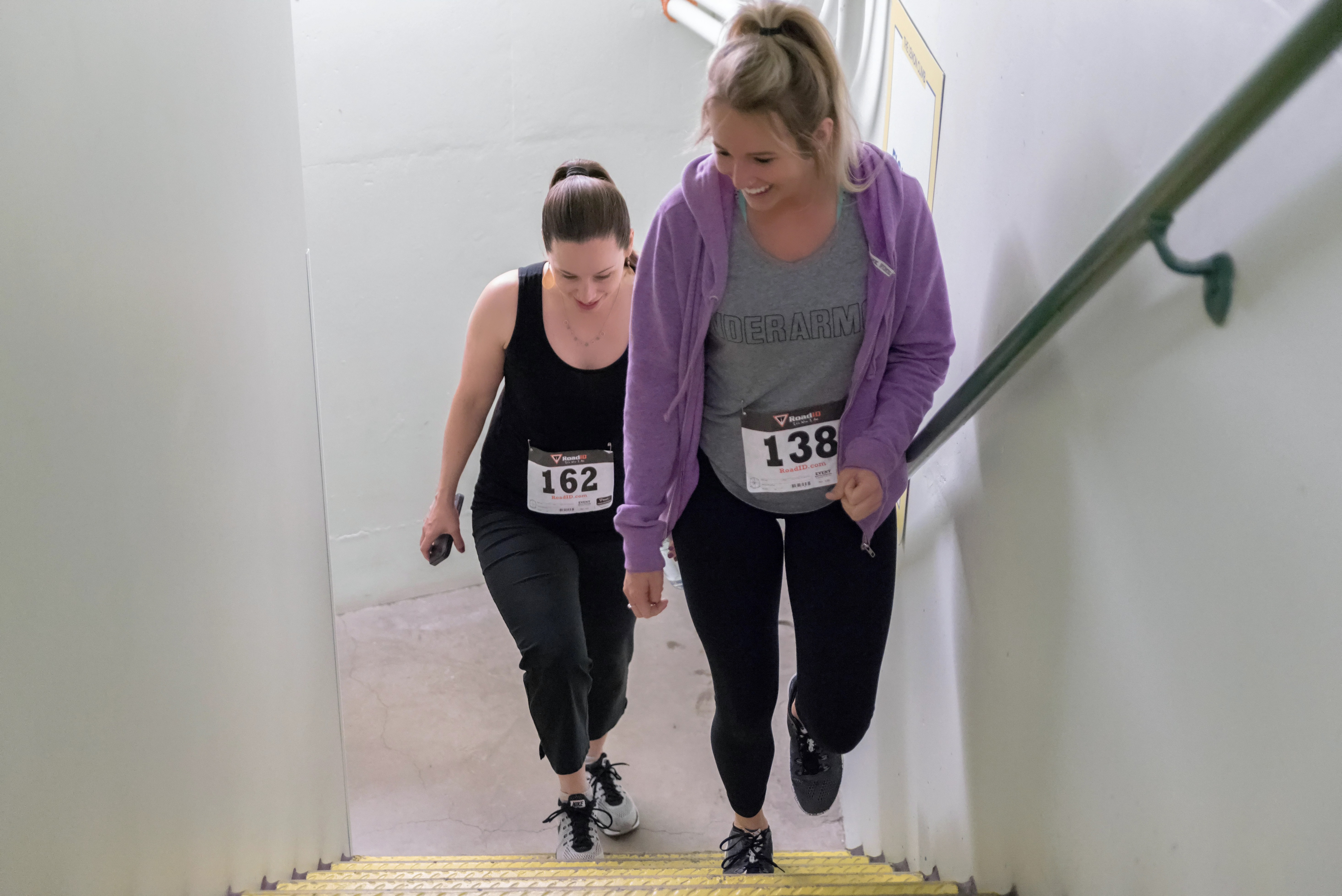 2 people climbing stairs
