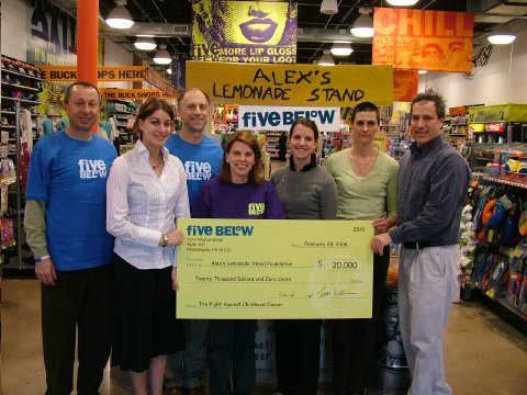 Five Below store employees presenting check to ALSF