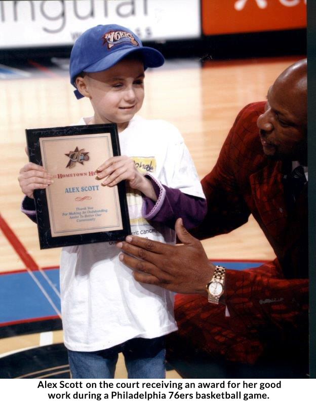 March Madness: More than the final score. ALSF founder Alex Scott receiving an award at a Sixers game.