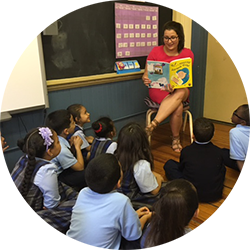 "A teacher reading ""Alex and the Amazing Lemonade Stand"" to her class"