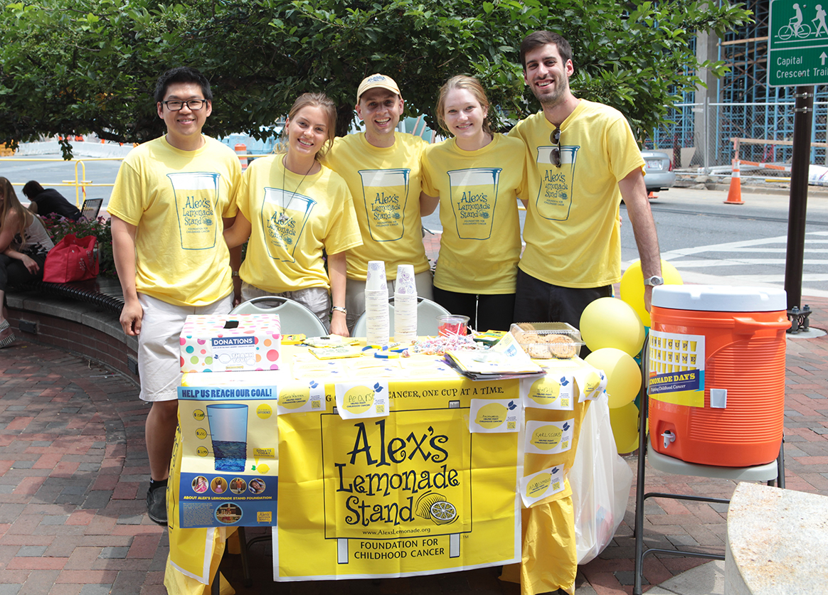 Group of people at a lemonade stand