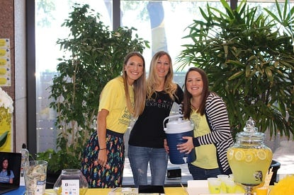 Group of coworkers at a lemonade stand