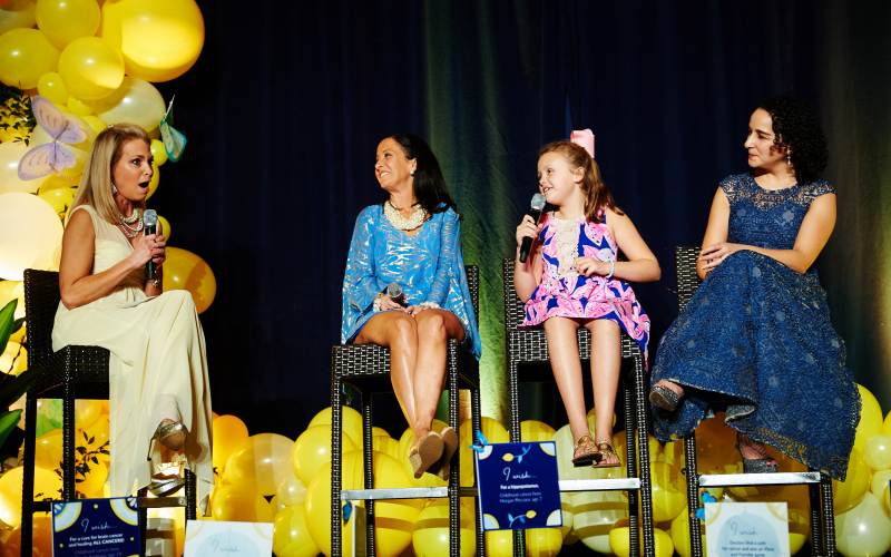 Above, Emily and Edie Gilger, together with their doctor, Yael Mosse, MD from the Children's Hospital of Philadelphia share their remarkable survival story with guests at the 2019 Lemon Ball.