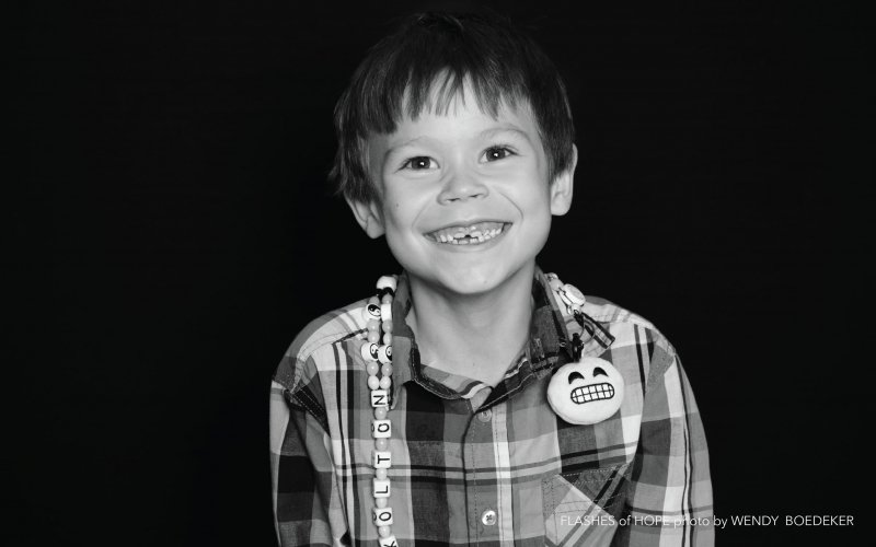 """Wendy Boedeker, from Denver, recalled one session:""""Midway through the photo shoot his mom said:'Tell Miss Wendy that you earned each of those beads on your lanyard for every procedure you went through.'"""