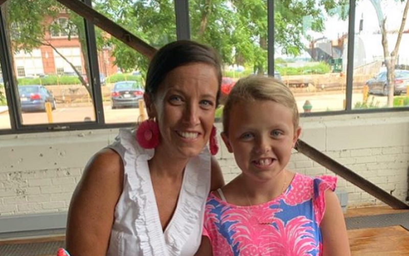 Edie, pictured above with mom Emily, celebrated her 10th birthday on June 7.