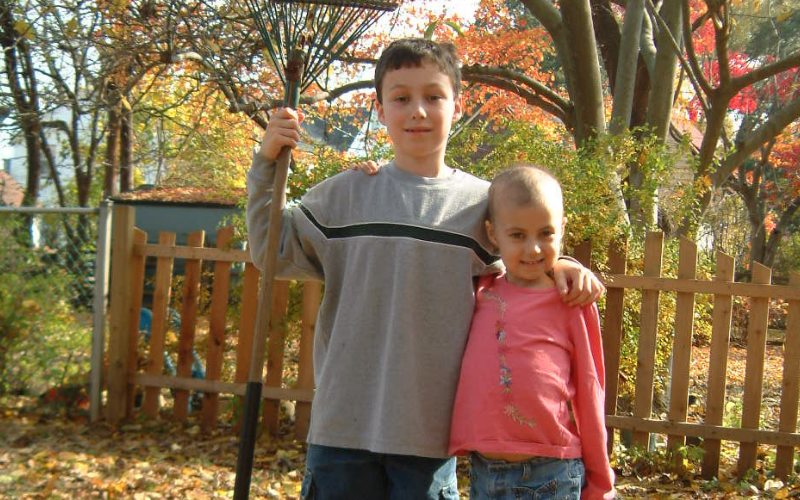 Pictured here: Patrick, age 8 and Alex, age 7 outside their home in Wynnewood, PA in the fall of 2003.