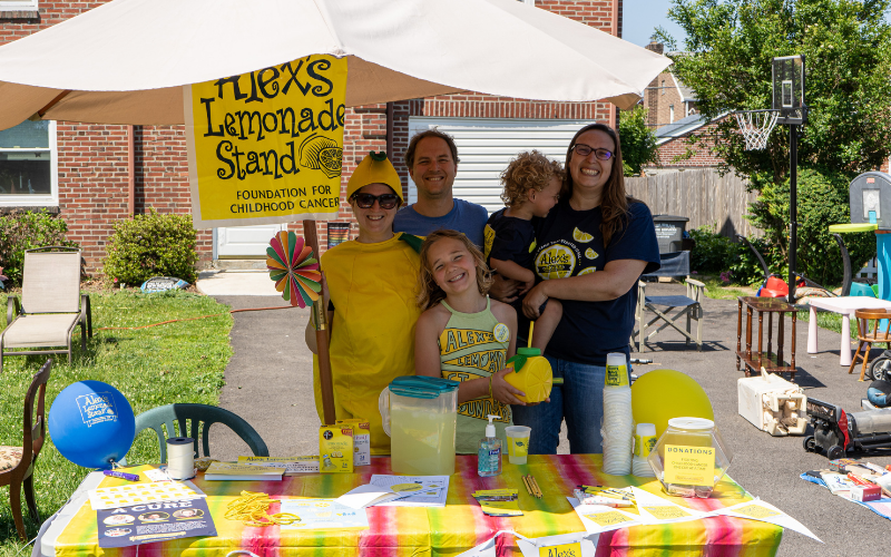 family at lemonade stand