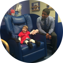 Malina was just a toddler when she was diagnosed with Ewing sarcoma. Pictured above, Malina with her oncologist, Dr. Glenson Samuel.While in treatment, Malina participated in a research study that required her to donate blood at each check-up.